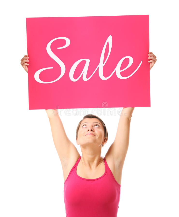 Spring sale. A portrait of a young happy woman holding a sale banner over white background stock photo