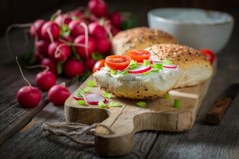 Spring sandwich with fromage cheese and cherry tomatoes. On dark background royalty free stock photo