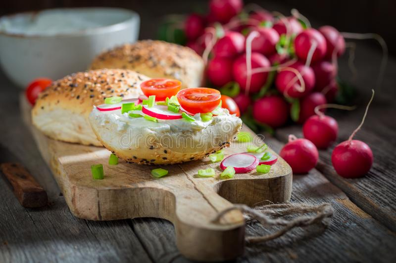 Spring sandwich with fromage cheese and fresh cherry tomatoes. On wooden table royalty free stock image