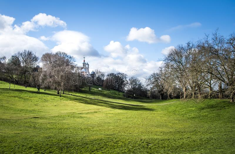 Spring season in park. Park meadow close to Greenwich UK in spring season during day, lit by the sun royalty free stock photo