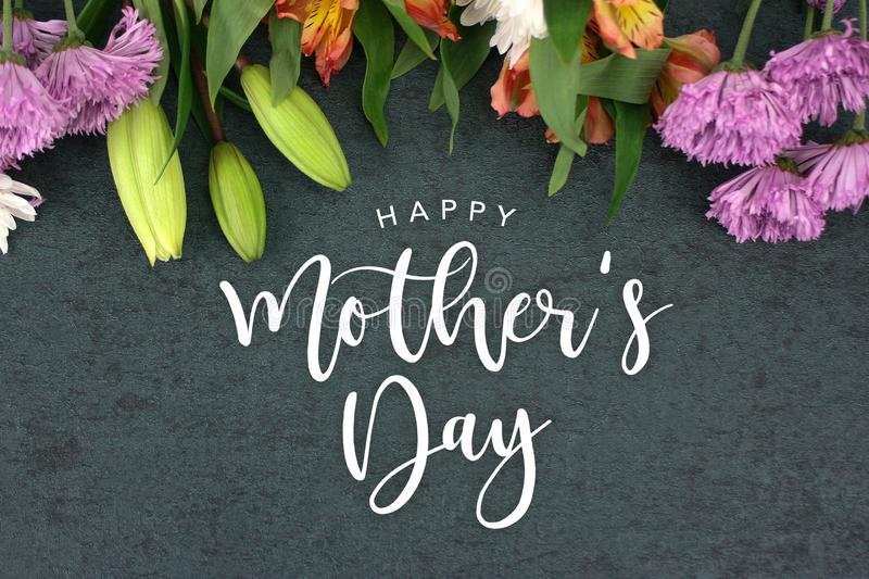 Spring season still life with Happy Mother`s Day greeting holiday script stock images