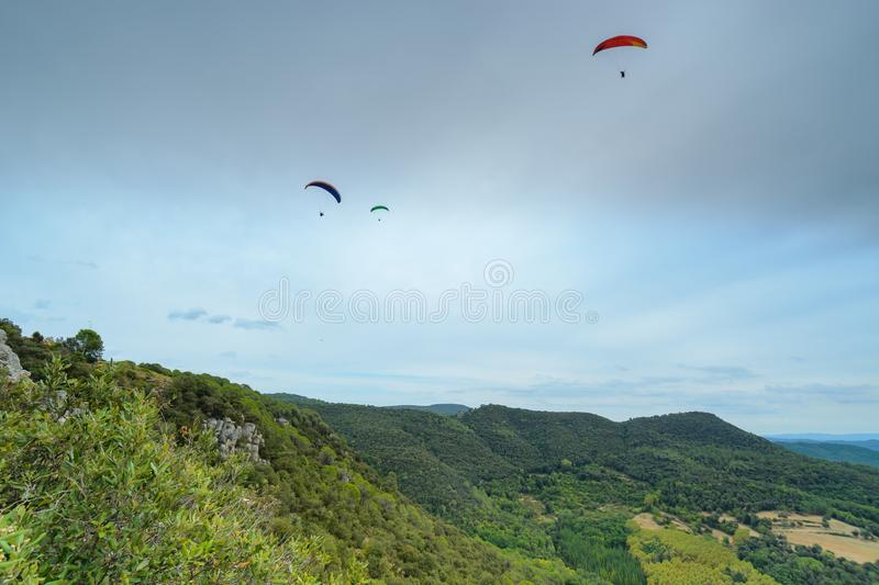 Group of paragliders above mountains royalty free stock photo