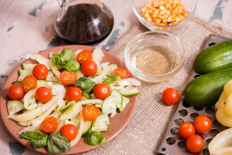 Spring summer diet salad with strawberries, cucumber, green field salad and yogurt mint sauce served in blue plate with cloth stock photos