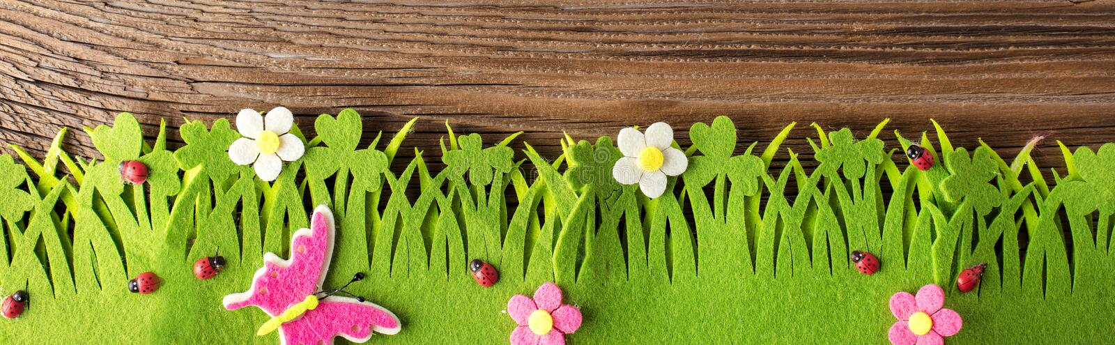 Spring or summer and grass field with wooden background. Spring or summer and grass field with wooden background royalty free stock image