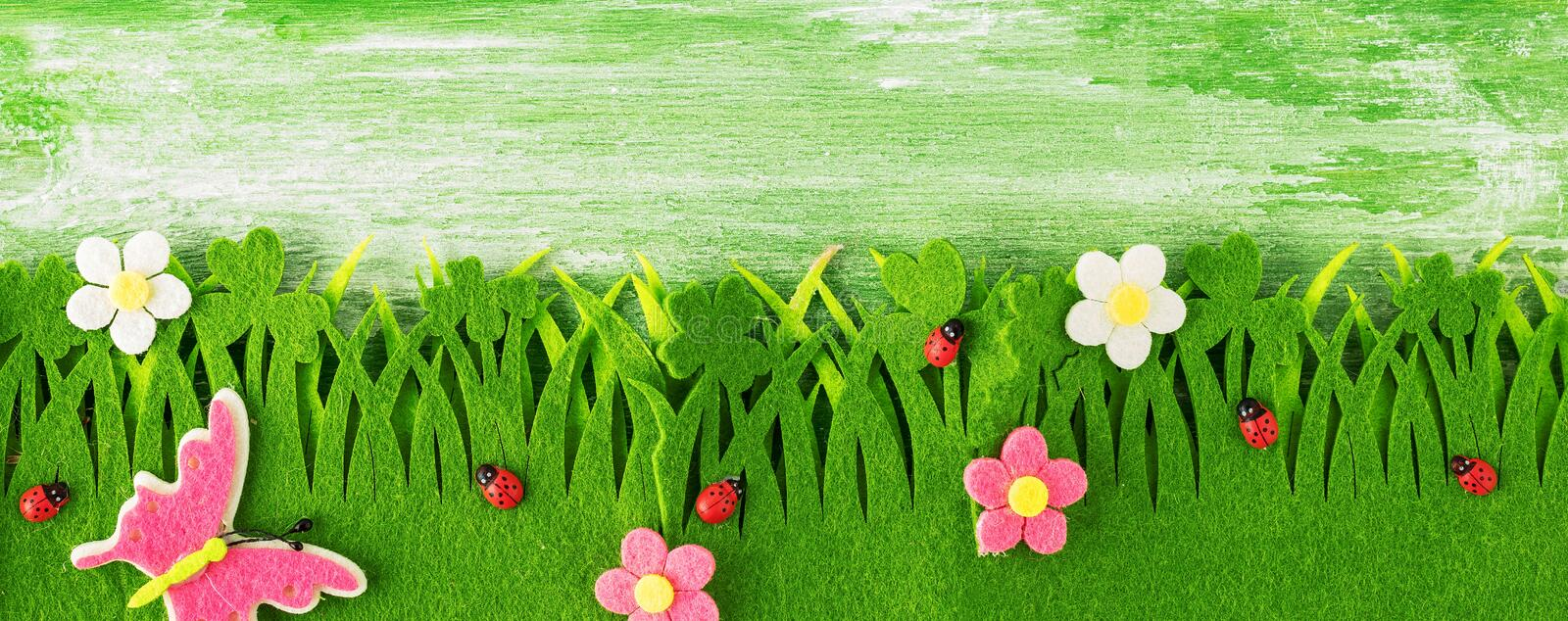 Spring or summer and grass field with wooden background.  stock photos