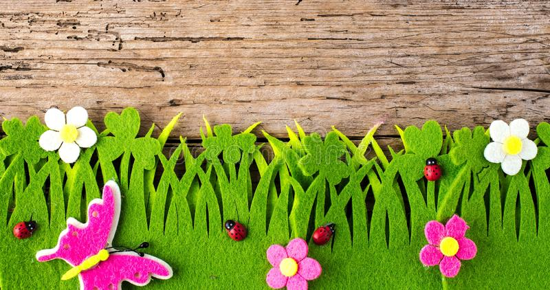 Spring or summer and grass field with wooden background. Spring or summer and grass field with wooden background royalty free stock photos