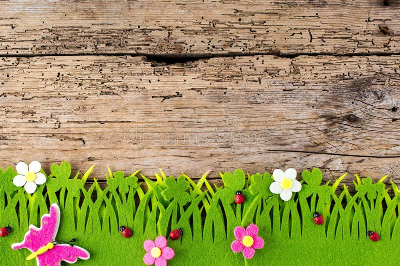 Spring or summer and grass field with wooden background. Spring or summer and grass field with wooden background stock photo