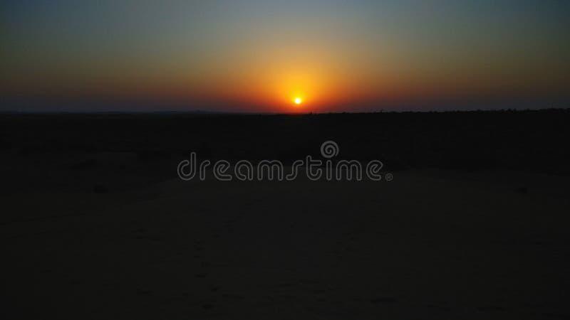 Sunset over the desert of Thar. Spring sun sunset. the Thar desert is getting colder royalty free stock photography