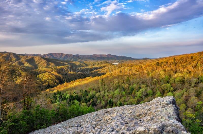 Spring sunrise, Knobby Rock, Blanton Forest, Kentucky. Warm morning light bathes the spring foliage from atop Knobby Rock in the Blanton Forest. This beautiful stock photos