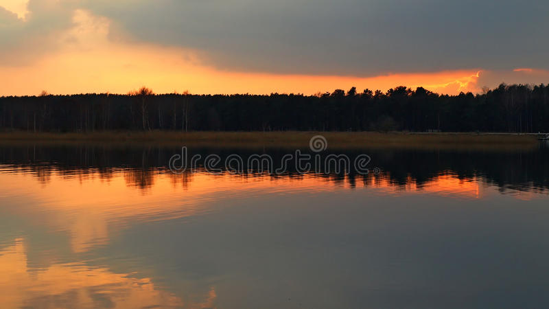 Sunset and orange sky over river stock images