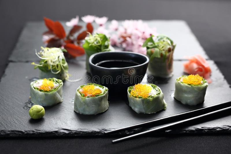 Spring sushi, sushi rolls with salmon, rucola, philadelphia cheese. stock photography
