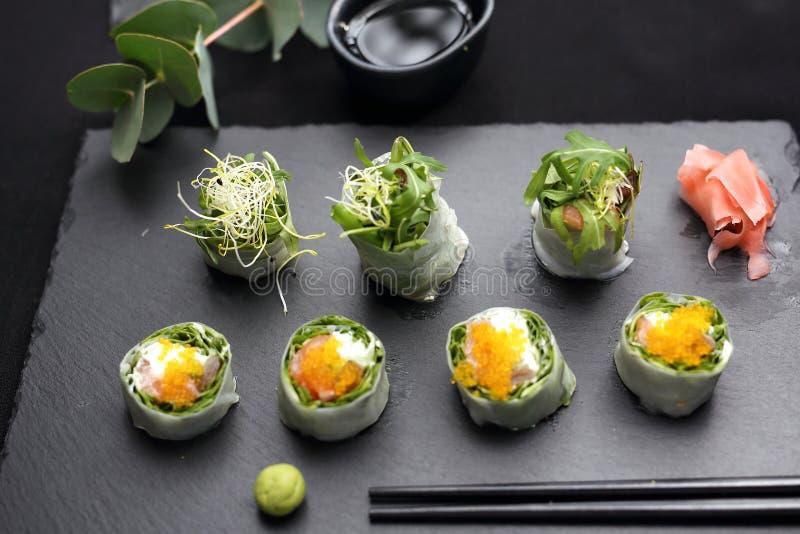 Spring sushi, sushi rolls with salmon, rucola, philadelphia cheese. royalty free stock photos