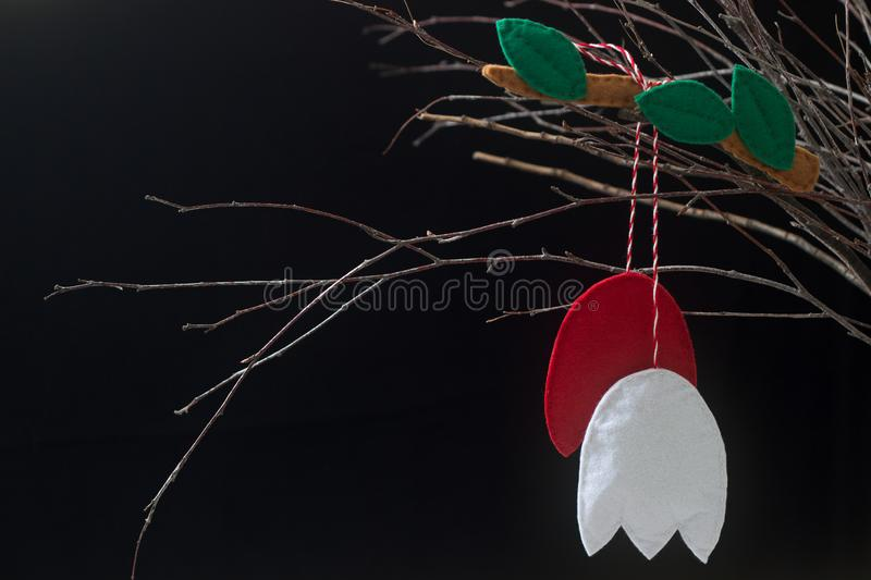 Spring symbol Martenitsa or martisor consisting of red and white pieces, traditional for Romania, Moldova, Bulgaria stock photo