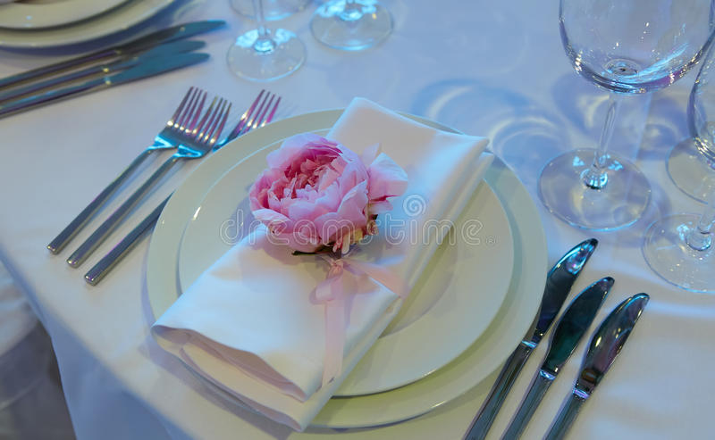 Spring table settings with fresh flower, napkin and silverware. Holidays background. Selective Focus. Spring table settings with fresh flower, napkin and royalty free stock photo