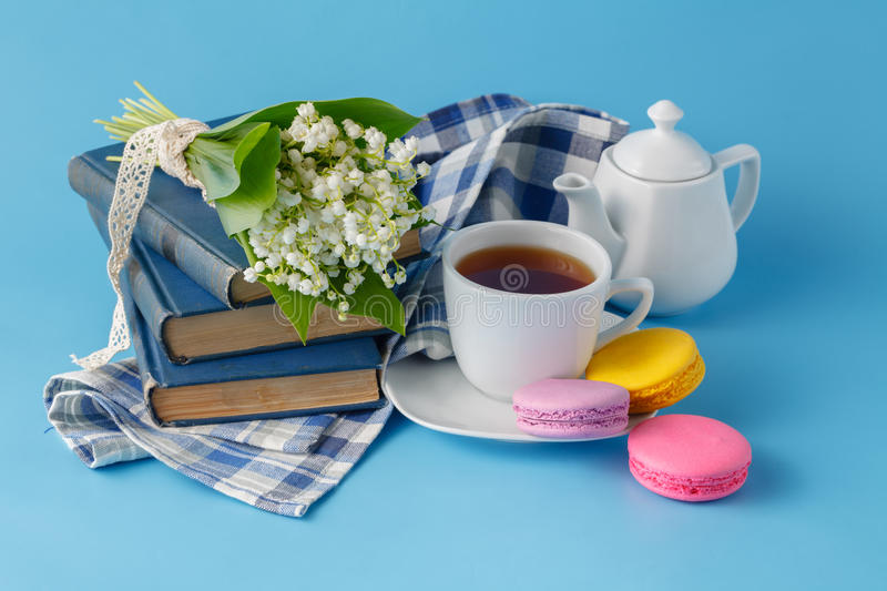 Spring tea drinking with books royalty free stock photography