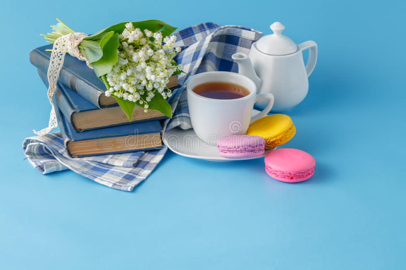 Spring tea drinking with books stock photo