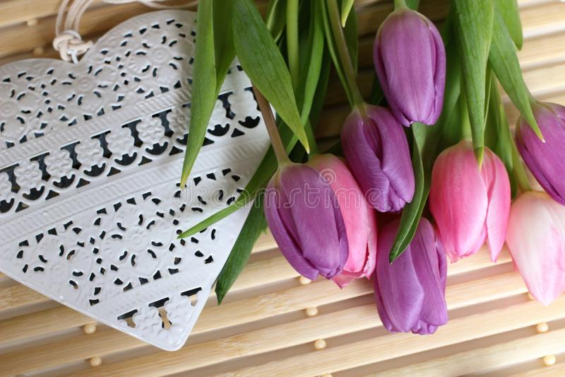 Spring time, Mothers day, flowers and candles, pink, purple, lovely time, nice smell, lovely colors, romantic colors, valentines. Spring time, spring colors royalty free stock image
