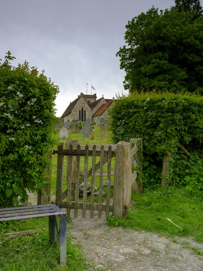 Spring time view on an overcast day from the north gate leading from the Lythes footpath of St Mary's church, Selborne, Hampshire royalty free stock images