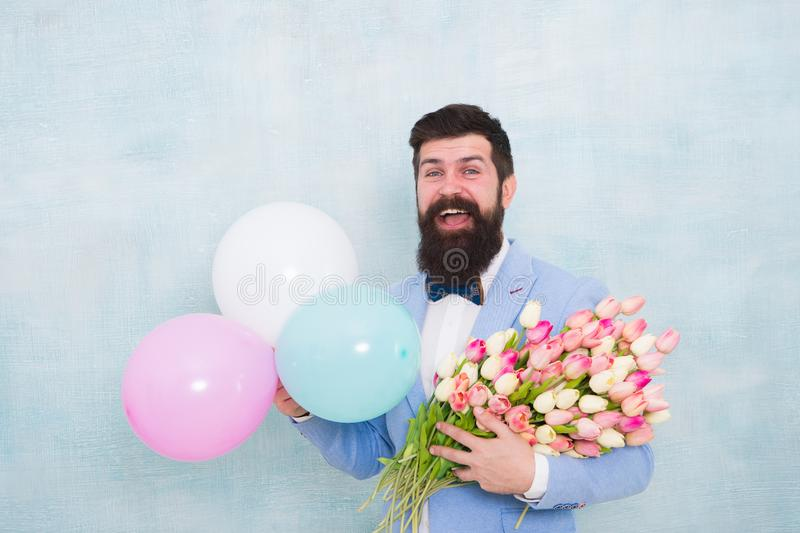 It is spring time. womens day. Formal mature businessman love date with flowers. Happy Birthday. bearded man in bow tie. With tulip flowers. spring bouquet. 8 stock images