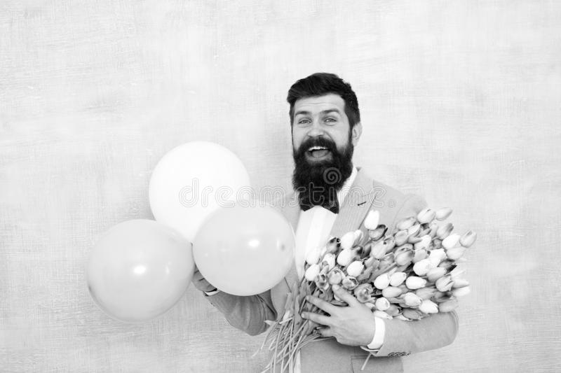 It is spring time. womens day. Formal mature businessman love date with flowers. Happy Birthday. bearded man in bow tie royalty free stock photos