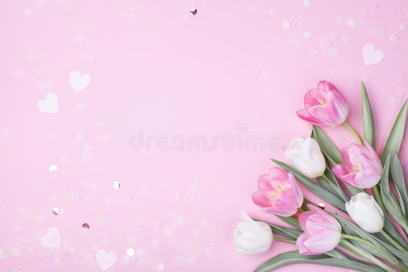 Spring tulip flowers on pastel pink background top view. Greeting card for International Women Day, Mother day. Flat lay. Style royalty free stock image