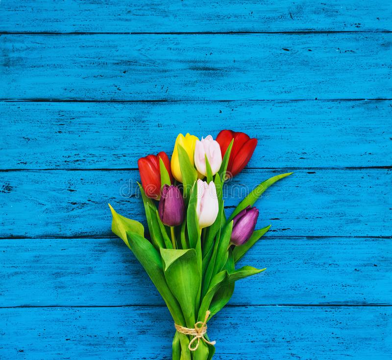 Spring tulips flowers on wooden background stock photo