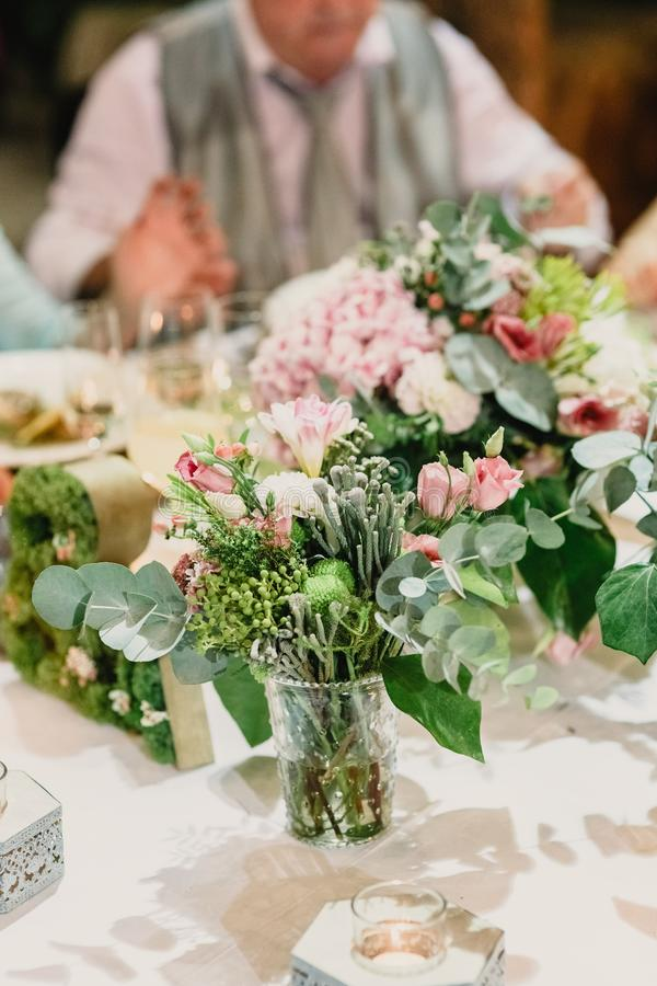 Spring vase in a Wedding. Wedding cutlery and centerpiece spring vase stock photo