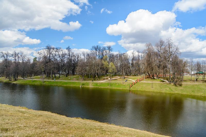 Spring view of the city park and pond royalty free stock image