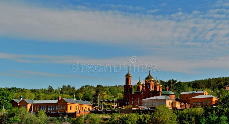 Spring view of the Resurrection Monastery in the rays of the morning sun. Spring view of the Resurrection Monastery in the city of Togliatti in the rays of the stock image