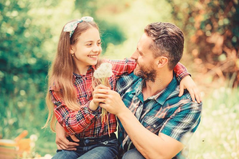 Spring village country. daughter and father love dandelion flower. little girl and happy man dad. earth day. ecology stock images