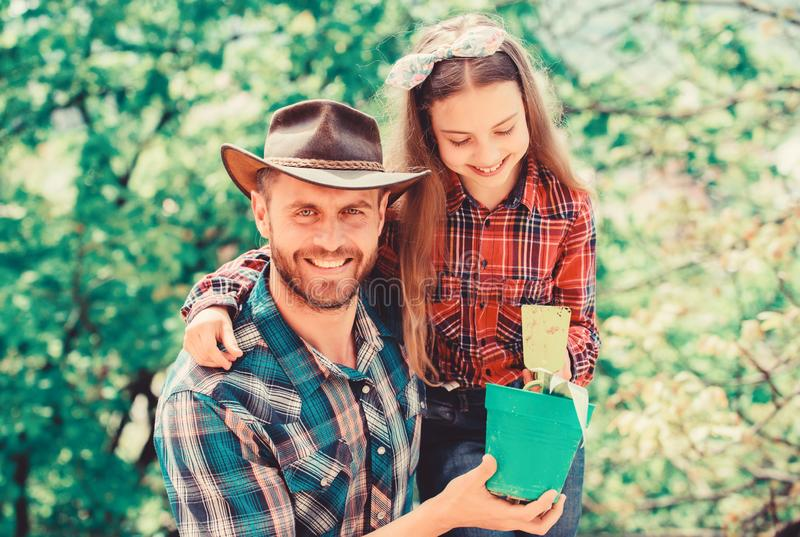 Spring village country. father and daughter on ranch. little girl and happy man dad. earth day. new life. ecology royalty free stock photo
