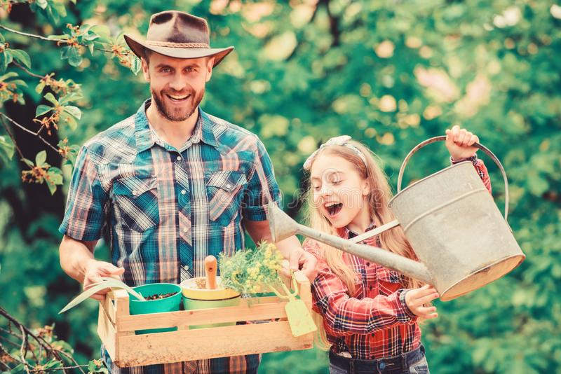 Spring village country. little girl and happy man dad. earth day. ecology. Watering can and shovel. family farm. father royalty free stock images