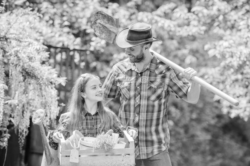 Spring village country. little girl and happy man dad. earth day. ecology. Gardening tools. family farm. summer farm stock photography