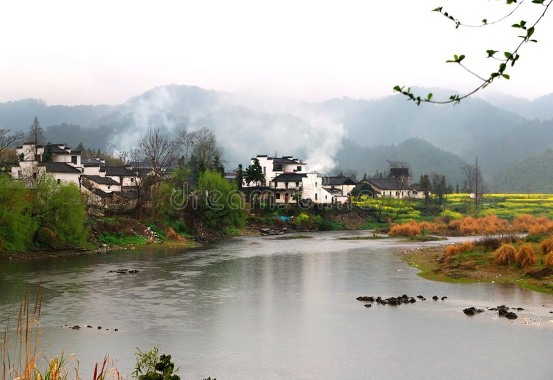 SPRING IN VILLAGE WITH RIVER stock photo