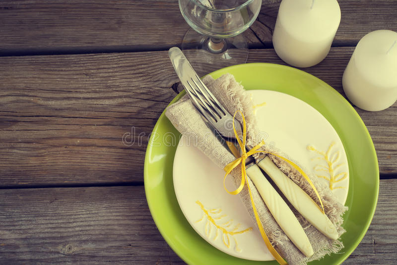 Spring vintage setting with cutlery, green plate stock image