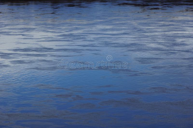 Spring water texture full-flowing river. Evening landscape with the river stock image