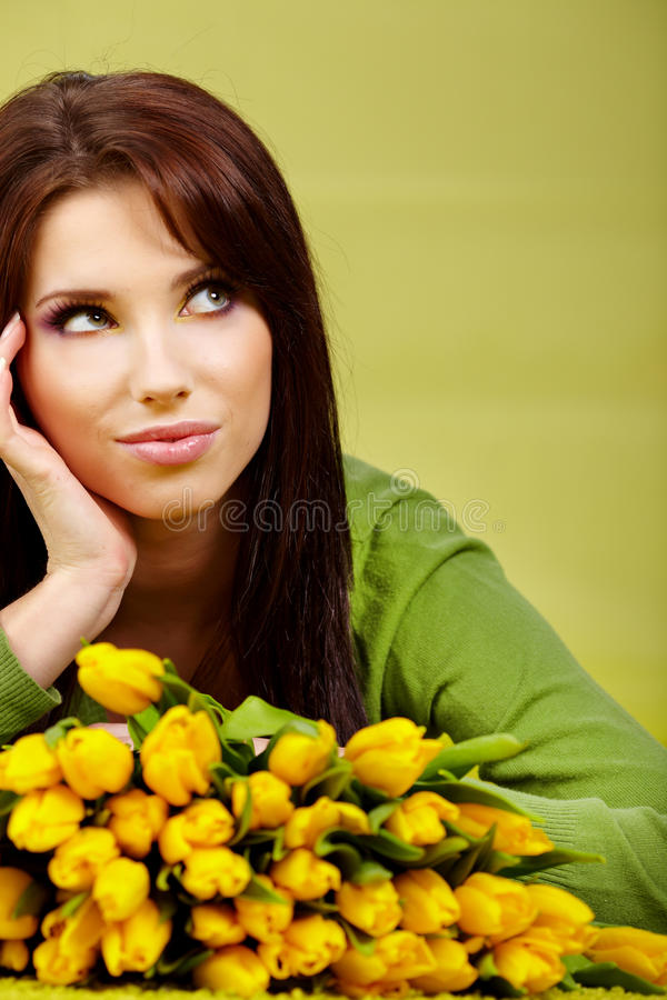 Spring woman. With yellow tulips royalty free stock image