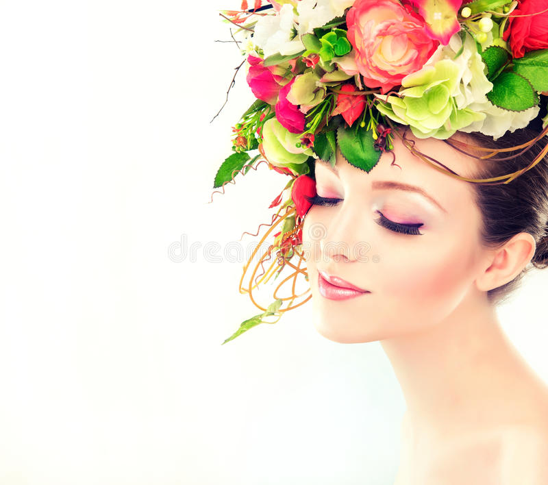 Spring woman. Beauty model girl with colorful flowers hairstyle stock photography