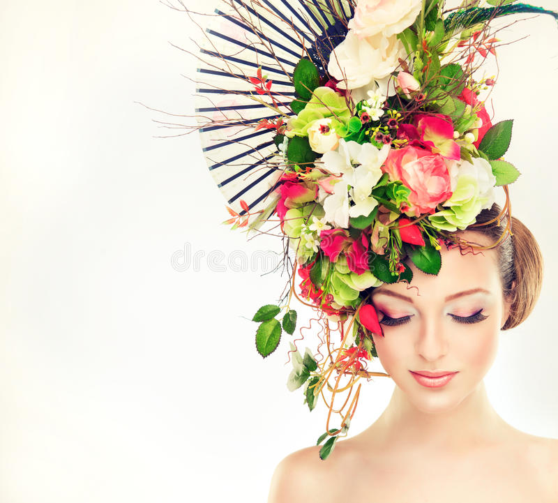 Spring woman. Beauty model girl with colorful flowers hairstyle stock photos
