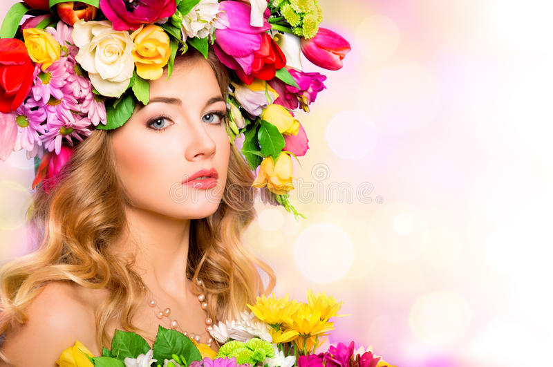 Spring woman, beauty portrait. With flowers hairstyle royalty free stock photo
