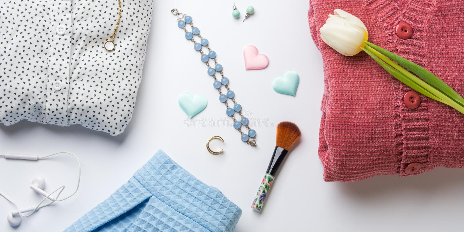 Spring woman clothes flat lay. Flower, hearts. Spring woman clothes and accessories flat lay. Flower, hearts. Valentine`s, mother, woman`s day concept. Pastel stock images