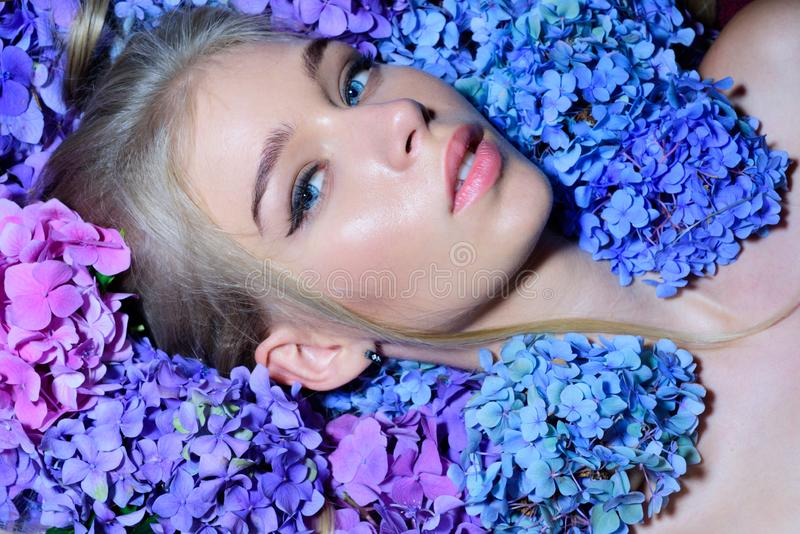 Spring woman with hydrangea flowers. girl with summer makeup. Summer beauty. Fashion portrait of woman. Healthy hair and royalty free stock photo