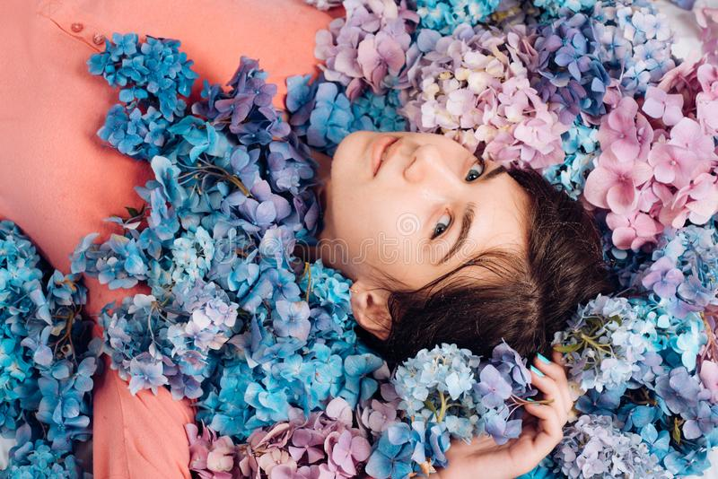 Spring woman with hydrangea flowers. Makeup cosmetics and skincare. Summer beauty. Fashion portrait of woman. Healthy royalty free stock photo
