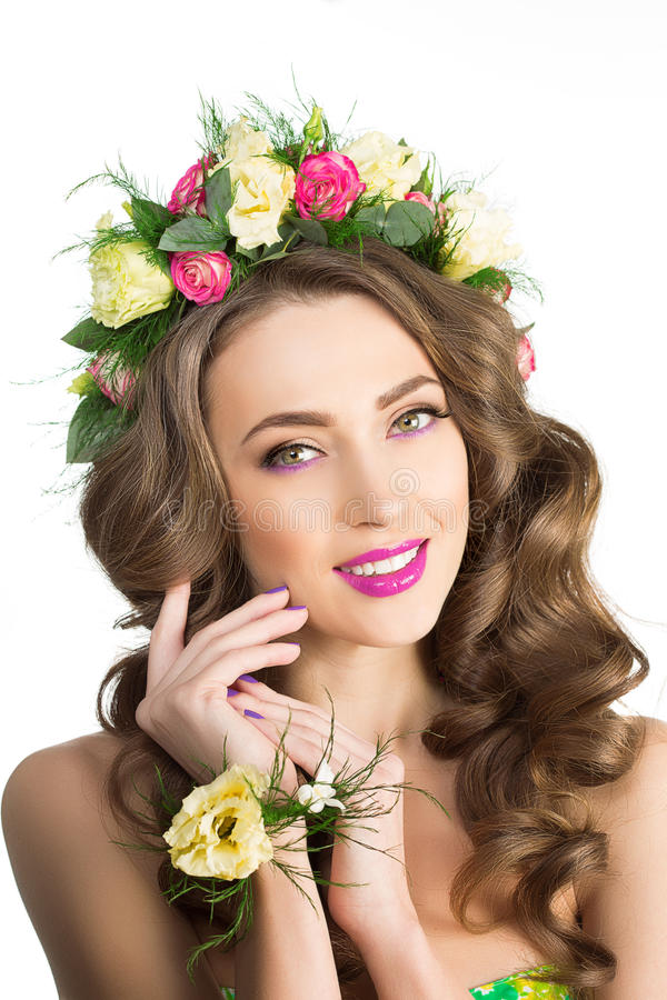 Spring woman. Young Girl with flowers. Beautiful model, wreath. & flowers bracelet. Bride, bridesmaid. makeup luxurious spa Lady make up Mascara for long lashes royalty free stock photo