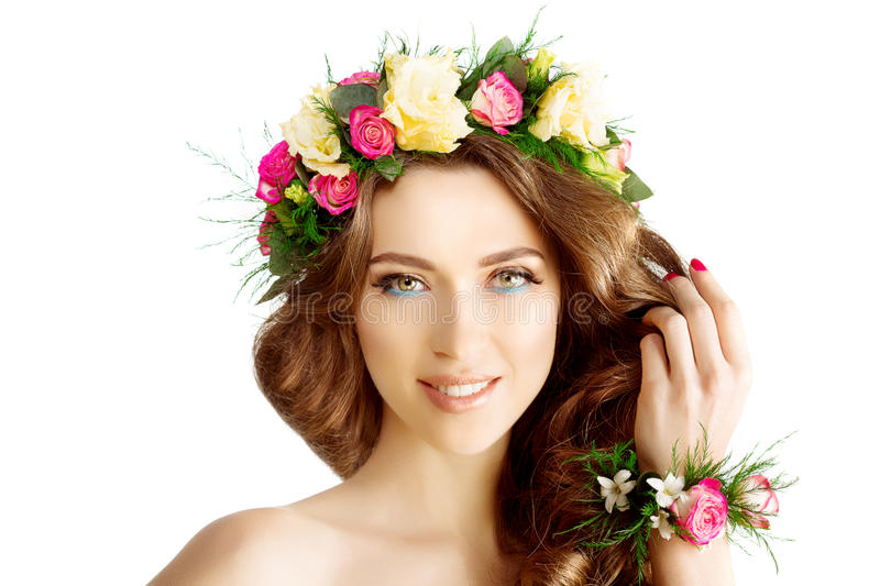 Spring woman Young Girl flowers Beautiful model wreath bracelet. Bride bridesmaid makeup spa Lady make up Mascara lashes lipstick lips eye shadow shiny hair royalty free stock photo