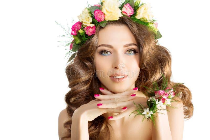 Spring woman Young Girl flowers Beautiful model wreath bracelet. Bride bridesmaid makeup spa Lady make up Mascara lashes lipstick lips eye shadow shiny hair stock photography