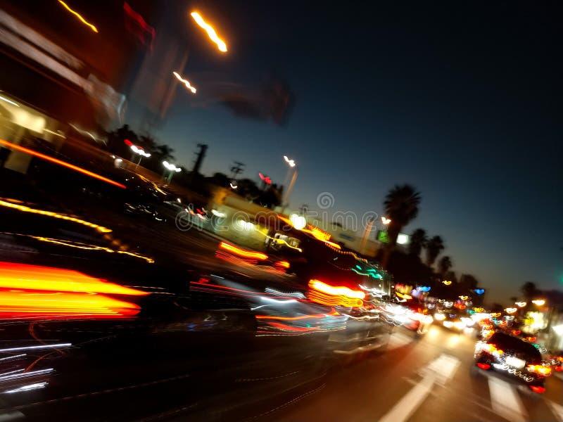 Springa för rusningstidbilar som får hemmet royaltyfri fotografi