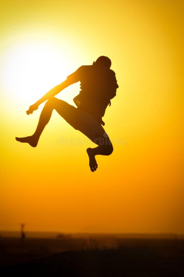 Springen Sie Schattenbild stockfotos