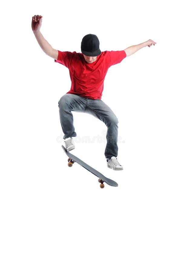 Springen van Skateboarder geïsoleerde op wit royalty-vrije stock foto