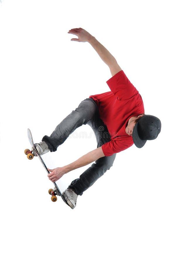 Springen van Skateboarder geïsoleerdn op wit stock afbeelding
